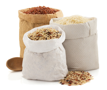 Foto de rice in paper bag isolated on white background - Imagen libre de derechos
