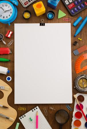 Foto de school supplies and paper on wooden background - Imagen libre de derechos
