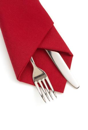 Foto de napkin, fork and knife isolated on white background - Imagen libre de derechos
