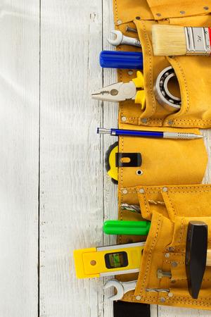 Foto de tools and instruments in belt on wooden background - Imagen libre de derechos