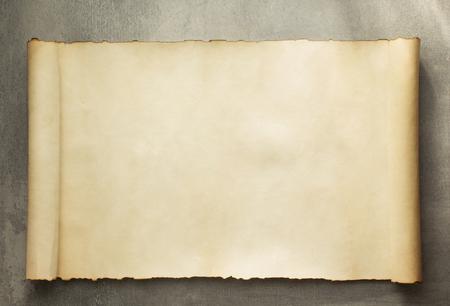 Foto de parchment scroll on old background - Imagen libre de derechos