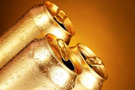 Foto de golden tin cans on yellow background - Imagen libre de derechos