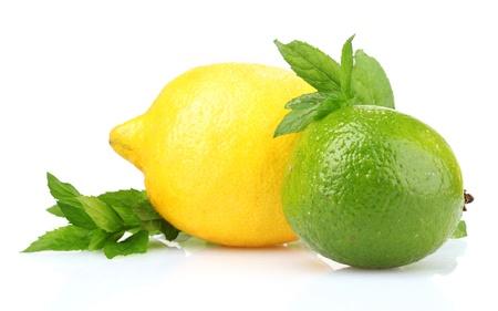 Foto de fresh lime, lemon and mint isolated on white - Imagen libre de derechos