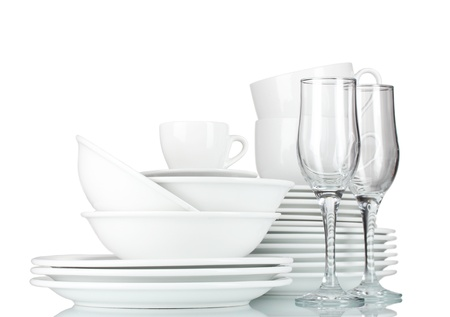 empty bowls, plates, cups and glasses on grey background