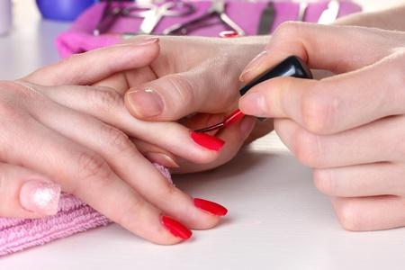 Manicure process in beautiful salon