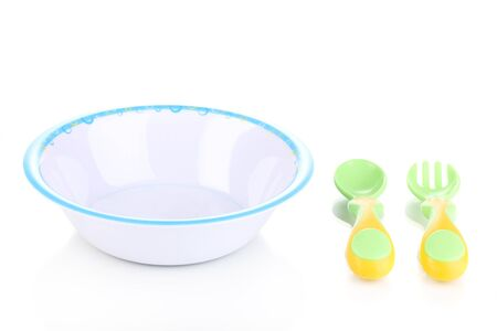 Baby plate with spoon and fork isolated on white