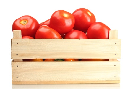 Ripe red tomatoes in wooden box isolated on white