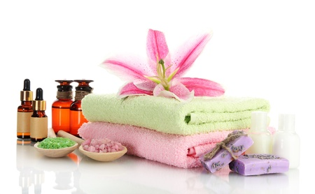 towels with lily, aroma oil, soap and sea salt isolated on white