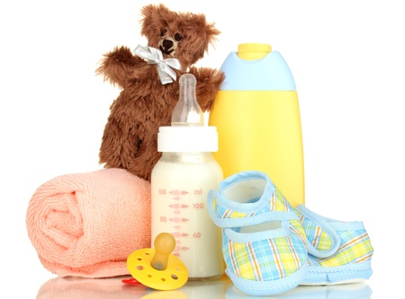 Photo pour Bottle of milk, pacifier and baby cosmetic with towel isolated on white - image libre de droit