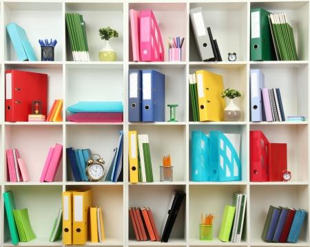 Photo pour White office shelves with different stationery, close up - image libre de droit