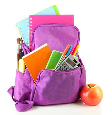 Foto de Purple backpack with school supplies isolated on white  - Imagen libre de derechos