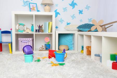 Photo pour Colorful plastic toys in children room - image libre de droit