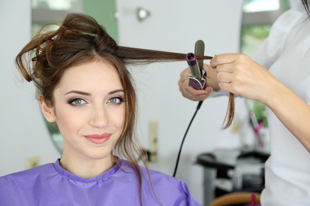 Photo for Young woman hairdresser do hairstyle girl in beauty salon - Royalty Free Image
