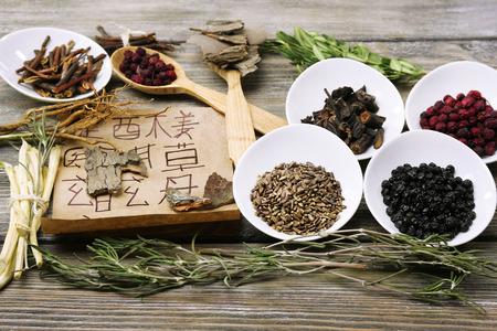 Foto de Traditional chinese herbal medicine ingredients with not real hieroglyphs, close-up - Imagen libre de derechos