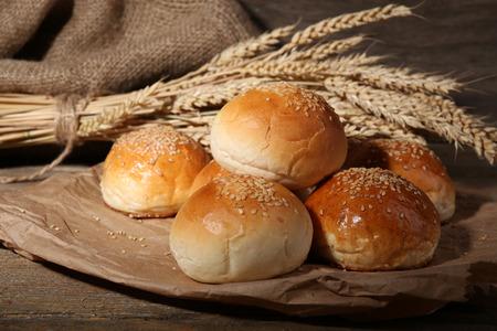 Foto de Tasty buns with sesame on wooden background - Imagen libre de derechos