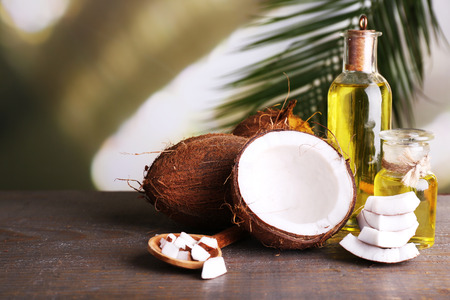 Photo for Coconuts and coconut oil on wooden table - Royalty Free Image