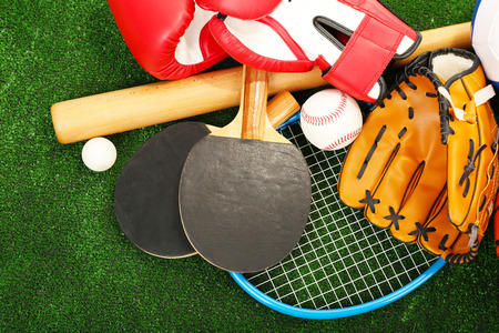 Photo pour Sports equipment on grass background - image libre de droit