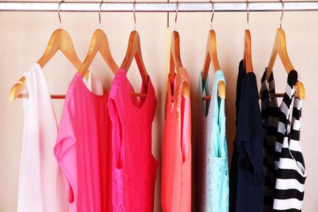 Foto de Female clothes on hangers in wardrobe - Imagen libre de derechos