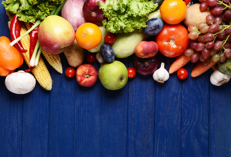 Photo for Fresh organic fruits and vegetables on wooden background - Royalty Free Image