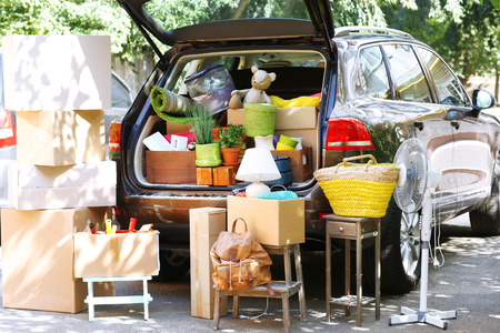 Photo for Moving boxes and suitcases in trunk of car, outdoors - Royalty Free Image
