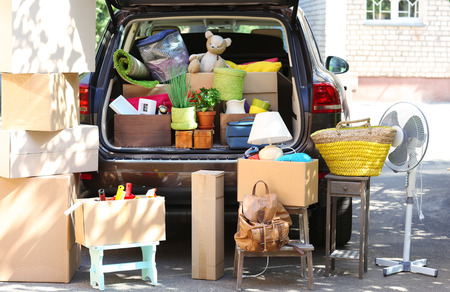 Foto de Moving boxes and suitcases in trunk of car, outdoors - Imagen libre de derechos