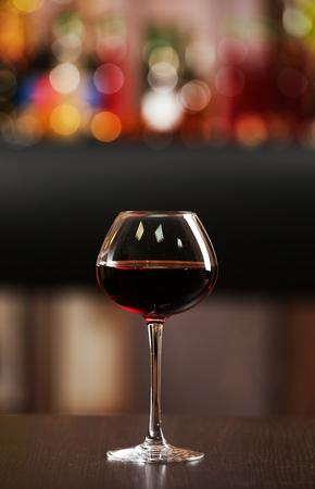 Foto de Glass of red wine in bar on blurred background - Imagen libre de derechos