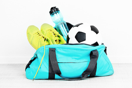 Photo pour Sports bag with sports equipment in room - image libre de droit