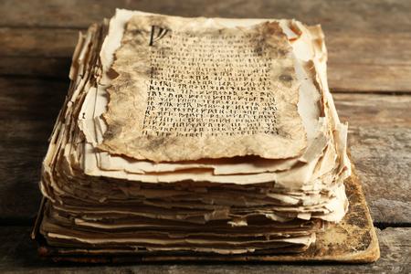Foto de Grunge papers with hieroglyphics  on wooden background - Imagen libre de derechos