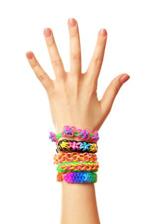 Photo pour Female hand with bracelets isolated on white - image libre de droit
