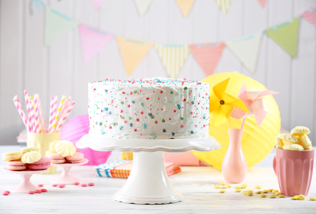 Photo for Birthday decorated cake on colorful background - Royalty Free Image