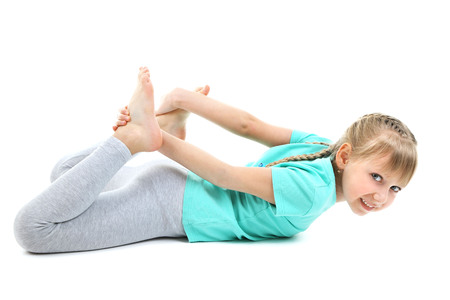 Photo for Little girl doing exercises isolated on white - Royalty Free Image