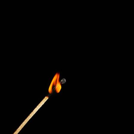 Foto de Burning match on black background - Imagen libre de derechos