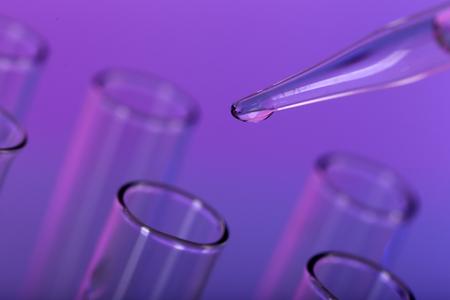 Foto de Test tubes on color background - Imagen libre de derechos