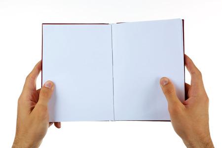 Foto de Male hands holding book isolated on white - Imagen libre de derechos
