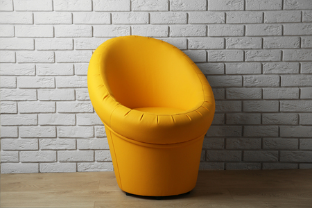 Photo for Modern chair on brick wall background - Royalty Free Image