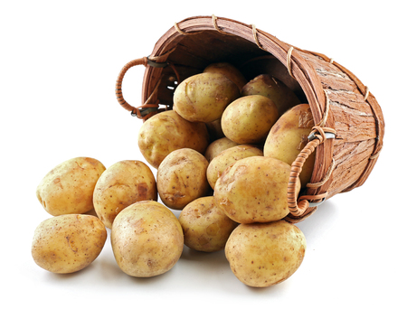 Photo pour Young potatoes in basket isolated on white - image libre de droit