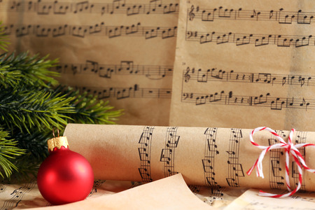 Foto de Music notes with Christmas decoration close up - Imagen libre de derechos