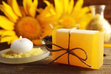 Photo pour Soap bar and Spa treatments and sunflower on wooden background - image libre de droit