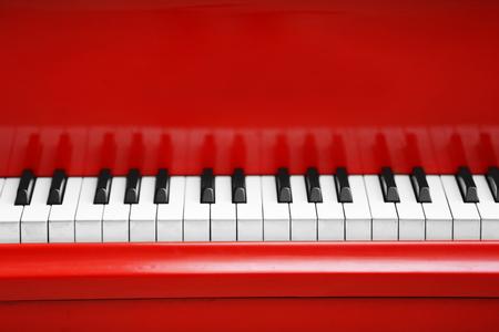 Foto de Piano keys of red piano close up - Imagen libre de derechos