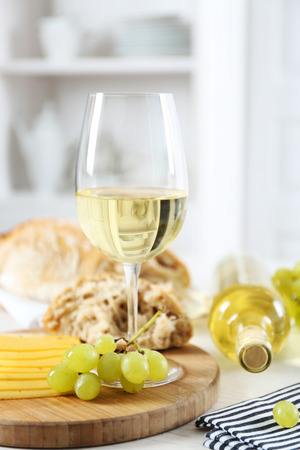 Photo pour Still life of wine, grape, cheese and bread on light background - image libre de droit