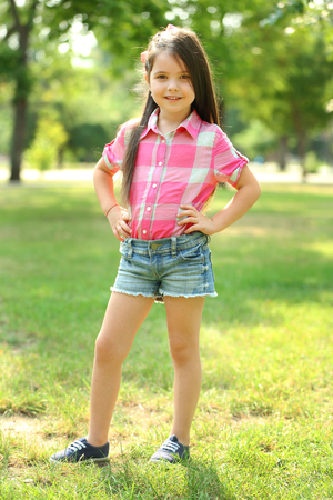 Photo for Happy little girl in the park - Royalty Free Image
