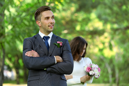 Photo for Groom  and bride with wedding bouquet on nature background - Royalty Free Image