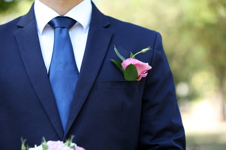 Photo for Groom with boutonniere outdoors - Royalty Free Image