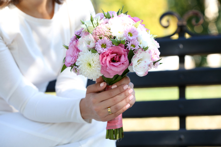 Photo for Beautiful wedding bouquet in hands of bride - Royalty Free Image