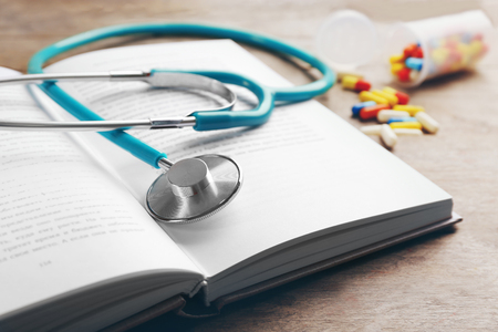 Photo pour Stethoscope on a book, close up - image libre de droit