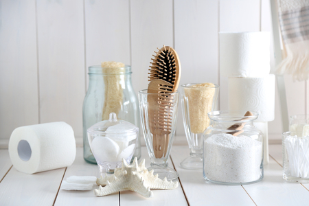 Photo for Bath accessories on wooden wall background - Royalty Free Image