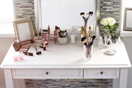 Photo pour Cosmetic set on light dressing table - image libre de droit