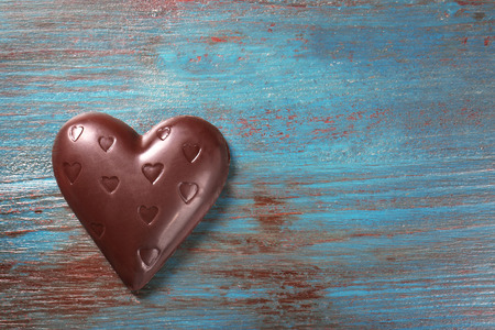 Photo for Chocolate heart on wooden background - Royalty Free Image