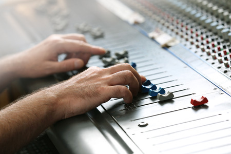 Photo for Hands on mixer in a recording studio, close up - Royalty Free Image