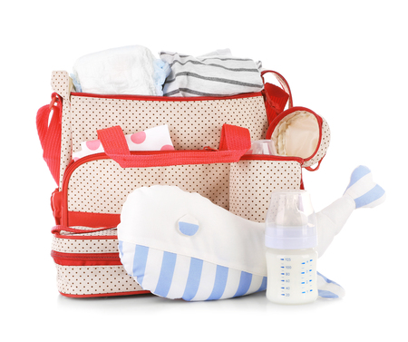 Photo pour Mothers bag with toy and accessories on white background - image libre de droit